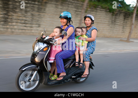 Vietnam, Nha Trang, Many people on one scooter - Stock Photo