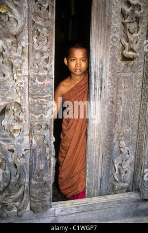 Young Buddhist monk at Shwenandaw Kyaung, Mandalay, Myanmar (Burma) - Stock Photo