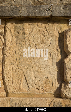 Relief carving depicting a jaguar eating a human heart on The Platform of Eagles and Jaguars in Chichen Itza, Yucatan, - Stock Photo