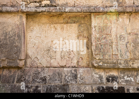 Stone relief of Quetzalcoatl-Kukulkan as the 'Morning Star' on the side panel of the Venus Platform in Chichen Itza, - Stock Photo