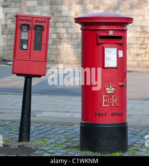 A Royal Mail post box next to a stamps vending machine in Windsor, Berkshire, UK. - Stock Photo