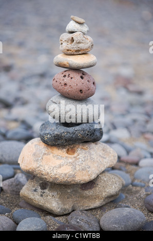 stack of wellness stones on the beach - Stock Photo