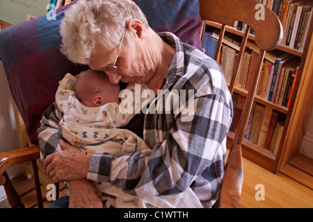 Grandmother napping with her newborn grandson. - Stock Photo