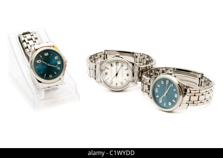 Three stainless men`s wristwatches isolated on white background - Stock Photo