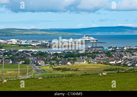 A general view over Kirkwall in Orkney towards the harbour with cruise ship at the pier - Stock Photo