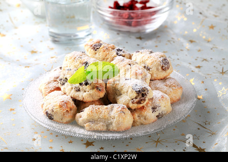 Mini Christmas stollen cakes with marzipan - closeup - Stock Photo