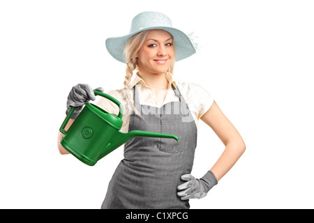 Portrait of a beautiful female gardener with watering can - Stock Photo