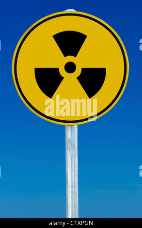 A radioactive sign isolated on a blue graduated sky. - Stock Photo