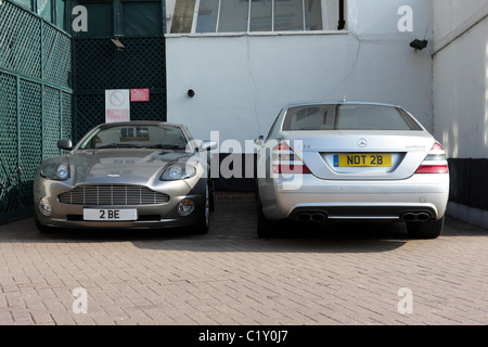 Humorous registration plates of an Aston Martin and Mercedes Benz vehicles. 2 BE NOT 2BE. - Stock Photo