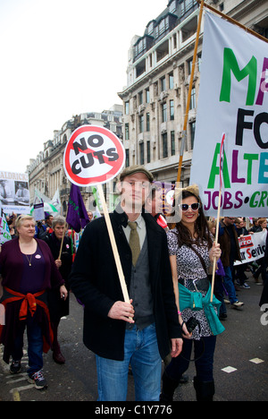 young couple with no cuts sign at March for the Alternative rally organised by the TUC, London, England - Stock Photo