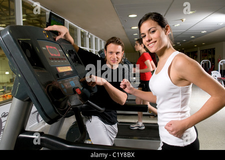 Image, a, woman, hold, holding, stand, standing, on, a, treadmill, track, at, gym, 20-30, years, years-old, tied, - Stock Photo