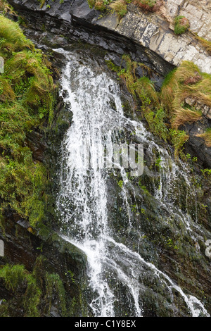 Waterfall on the South West Coast Path, south of Hartland Quay, Devon - Stock Photo