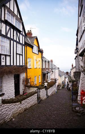 Narrow, steep street leading to the harbour, Clovelly, Devon. - Stock Photo