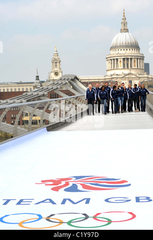 17 of the 27 Official Team GB 2012 Ambassadors pose on the Millenium Bridge in London near the Tate Modern. Southbank. - Stock Photo