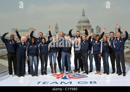 17 of the 27 Official Team GB 2012 Ambassadors cheer on the Millenium Bridge in London near the Tate Modern. Southbank. - Stock Photo