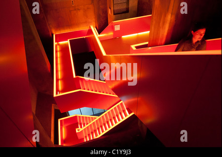 Interior red lighting on stairway at former coal mine now museum and UNESCO world heritage site at Zollverein in - Stock Photo
