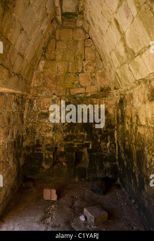 Interior room with corbel arch in El Palacio or The Palace at the Puuc style Maya ruins of Sayil, Mexico. - Stock Photo