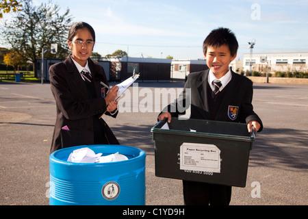 schoolchildren 'school children' recycling paper - Stock Photo