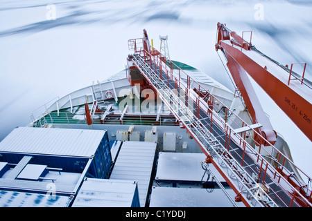 Ice breaker RV Polarstern moving through the ice in Antarctica - Stock Photo