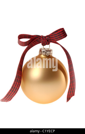 This stock photo shows a simple gold Christmas ornament glass ball with a red and green plaid ribbon bow tied through - Stock Photo