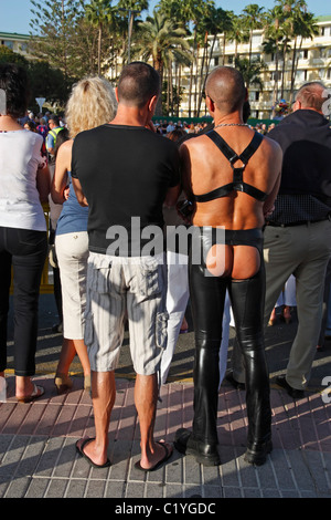 Man wearing leather chaps showing bare bottom at carnival in Playa del Ingles on Gran Canaria - Stock Photo