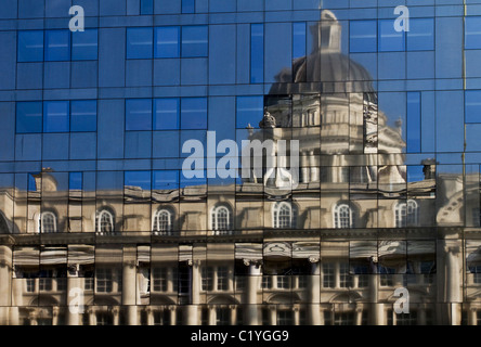 Modern design Glass-walled Building with Reflections of the Port of Liverpool Building, in the Mann Island Development, - Stock Photo