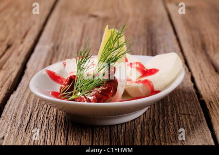 Mozzarella cheese with garnish and raspberry balsamic reduction - Stock Photo