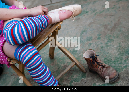 Young girl practicing ballet in her backyard, Czech Republic - Stock Photo