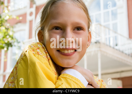 The happy little girl goes to school - Stock Photo
