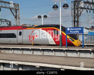 A class 390 'Pendolino' train operated by Virgin Trains leaving Manchester Piccadilly station, bound for London. - Stock Photo