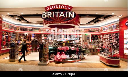 People at the 'Glorious Britain' souvenir shop, Terminal 5, heathrow airport London UK - Stock Photo