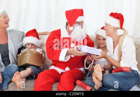 Santa Claus with a happy family - Stock Photo