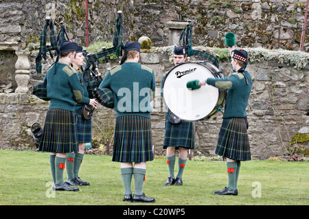 Members of the British Army's Officer Training Corps (OTC) playing in a Pipes and Drums Band competition - Stock Photo