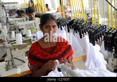 India, Tamil Nadu, Tirupur , women work in fair trade textile factory, production of garments and apparels for export - Stock Photo