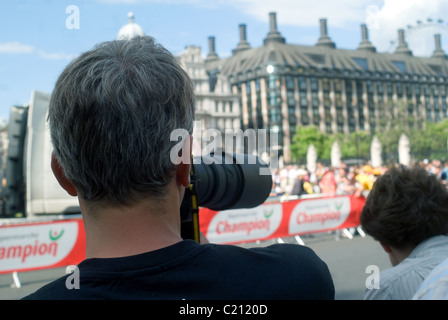 Photographer waiting for something to happen in a sport event from behind - Stock Photo