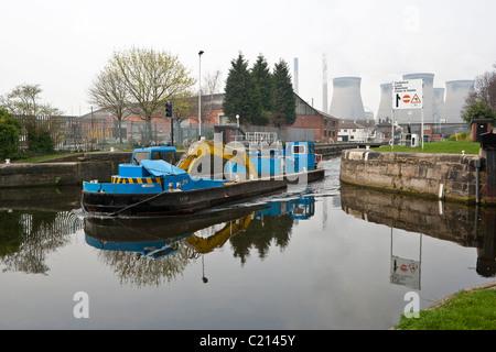Barge leaving Ferrybridge Lock Aire & Calder Navigation. - Stock Photo