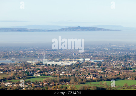 Autumn morning mist lying between May Hill and Brockworth over the city of Gloucester, Gloucestershire, England, - Stock Photo