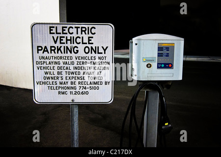 Electric vehicle charging station in a California shopping mall parking garage. - Stock Photo