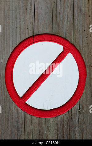 Painted Red and white no entry sign carved into wood - Stock Photo