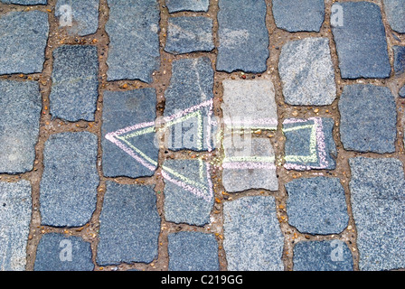 Arrow in Pavement - Stock Photo