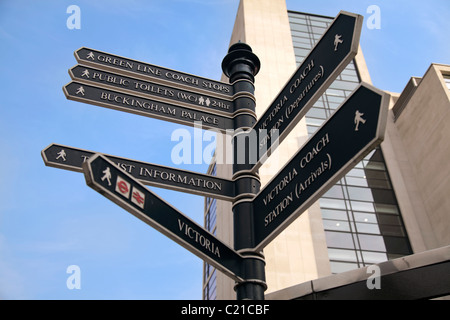 Direction sign in Victoria London - Stock Photo
