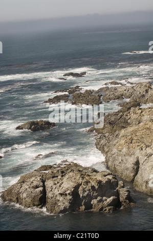 Rocky coast line looking north on Jamestown in Rhode Island - Stock Photo