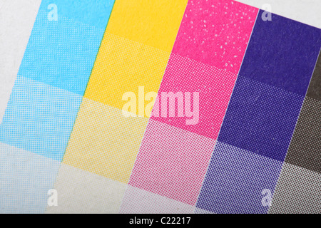 Printers printing CMYK colour test print on packaging four 4 color processing printing - Stock Photo