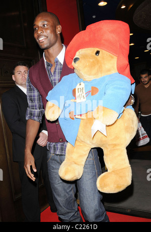 Carlton Cole holds a big Paddington Bear soft toy as he leaves the launch of Wrappz BBC Children in Need 2009 product - Stock Photo