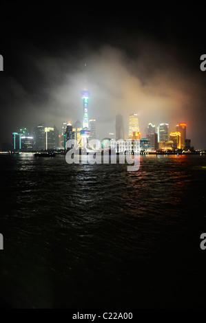 Night Skyline of Shanghai in Dust storm - Stock Photo