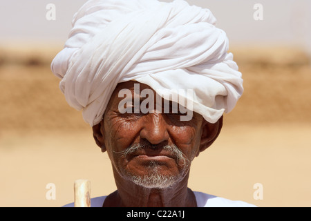 Portrait of an old Sudanese man wearing turban - Stock Photo
