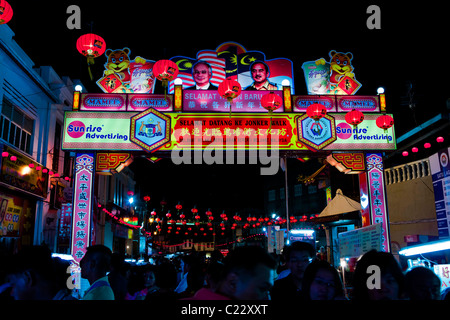 Locals and tourists mix at the start of Jonker walk in Melaka's Chinatown - Stock Photo