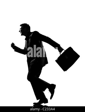 silhouette caucasian business man happy running ith briefcase full length on studio isolated white background - Stock Photo