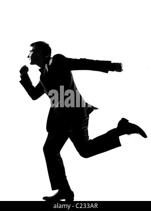 silhouette caucasian business man running profile full length on studio isolated white background - Stock Photo