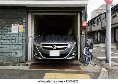Car parked inside domestic garage garage attached to for Small house big garage